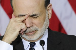 Bernanke rubs his eyes as he waits for the start of a meeting of the Financial Stability Oversight Council in Washington