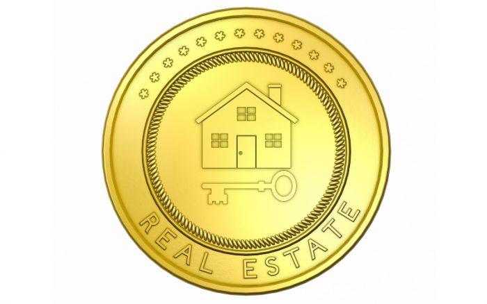 Pièce d'or frappée d'une maison